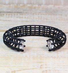This Awesome Black Statement Bracelet has two zirconia stones set in the opening. The bracelet is made of Nylon and is pleasant to wear. This eye-catcher looks great to a dress as well as to t-shirt and jeans.
