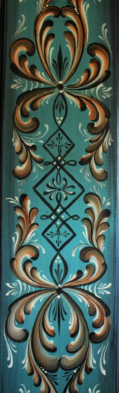 Beautiful Norwegian Rosemaling done in Oppdal Style.... This bass wood plaque is 24 x 6 x 3/4, and has a Nordic Antiqued Blue background, with a Onyx glaze over the top, Onyx sides and back. It has Rosemaling in the Oppdal Style down the front, in Brown, Gold, Red and White scrolls. White and deep brown line work and tear drop accents. The design and painting are original, and my signature and date are on the back: Cathy Koball 2014. There are several coats of varnish covering it for i...
