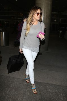 Get the Look: Khloe Kardashian's LAX Airport Gray Sheer Knit Sweater, White Jeans, and Giuseppe Zanotti Coline Shell Embellished Sandals