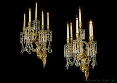 BACCARAT  (worked from 1764) ,An Important Pair of Gilt-Bronze and Cut-Glass Figural Wall Appliqués