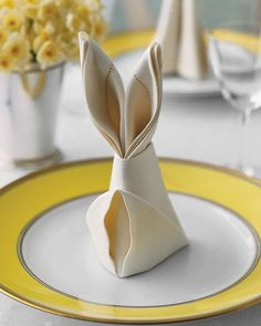 Bunny Fold for Napkins. These Easter rabbit shaped napkins are an easy way to dress up napkins on your Easter table which only require a few simple folds. http://hative.com/creative-easter-party-ideas/