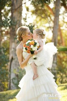 wedding pictures ideas - bride kiss the flower girl