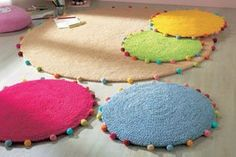 Round mats with pom pom trims. Very sweet, not sure what these ones are made of.