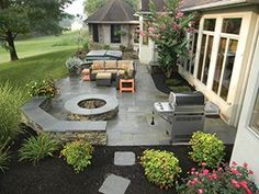 Work with professionals to create a landscaping layout that works for your familys needs. This patio, designed by Hively Landscapes, was designed with room for a fire pit, lounge area, hot tub and grill station—perfect for outdoor entertaining.