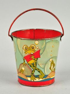 "Marked ""Fern Bisel Peat"" and ""Ohio Art"". Shows a frog reading a book under water surrounded by fish. Unusual and nice looking design. Pail has been used and is slightly misshapen. Scratching and litho loss on the inside. Old Fashioned Toys, Bucket And Spade, Sand Toys, Beach Toys, Metal Toys, Vintage Tins, Old Antiques, Antique Toys, Frogs"