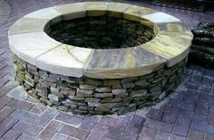 Stone fire Pit - More my style and they actually used the right kind of brick.