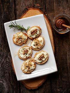 Warm goat cheese toasts with walnuts, rosemary + honey