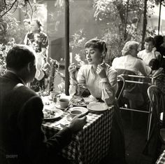 """Circa 1953. """"Actress Audrey Hepburn with dining companion in Mexico."""""""