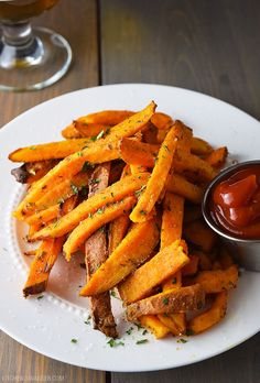 Who said healthier came at the cost of flavor? Simple restaurant style baked sweet potato fries seasoned with garlic powder, paprika, salt and pepper.