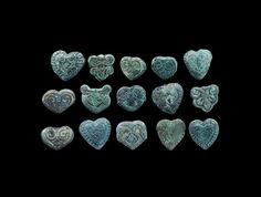 """Viking Belt Mount Group 10th-14th century AD. A mixed group of bronze heart-shaped belt mounts. 26 grams total, 12-14mm (1/2"""")."""