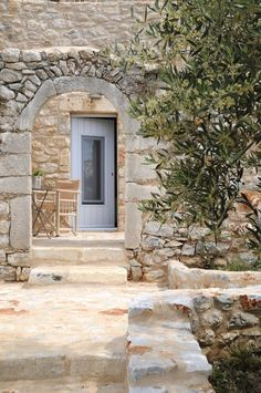 example of an arched stoned wall entry..