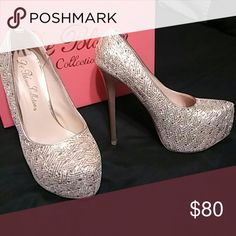 I  never wear this heels there brand new... There a beautiful golden color size 6 in us 7 Diamonds Shoes Heels
