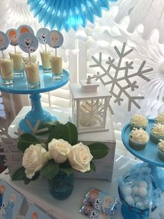 White roses at a Frozen birthday party! See more party planning ideas at CatchMyParty.com!