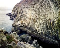 South Stack Formation Anglesey | #Geology #GeologyPage #Wales  The South Stack Formation is a sequence of late Neoproterozoic metasedimentary rocks exposed in northwestern Anglesey North Wales. The outcrop of this formation at South Stack was chosen as one of the top 100 geosites in the United Kingdom by the Geological Society of London for its display of small-scale folding.  Geology Page www.geologypage.com