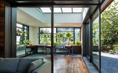 Beautiful windows with lots of plants, near a living room and verandah
