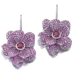 Pair of ruby, sapphire and diamond earrings, Michele della Valle. Each designed as a flower, the petals pavé-set with circular-cut pink sapphires, the centre set with a cushion-shaped ruby within a border of brilliant-cut diamonds. Sapphire And Diamond Earrings, Pink Sapphire, Do It Yourself Fashion, High Jewelry, Jewellery, Jewelry Box, Crochet Earrings, Flower Earrings, Fashion Jewelry