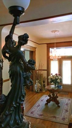 Newel post light i think my house originally had one of these and i the one of a kind cast bronze newel post lamp overlooking the entrance aloadofball Image collections