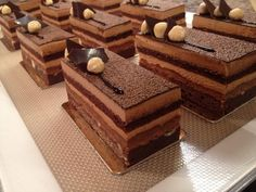 """Our new patisserie - """"Nocciola"""". Hazelnut brownie, topped with praline crunch, coffee & milk chocolate mousse, and flourless chocolate sponge, finished with hazelnuts and chocolate shards (Eponine Patisserie & Chocolaterie)"""
