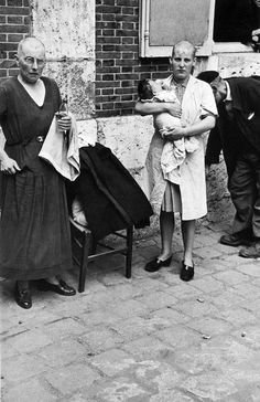Robert Capa - France, Eure-et-loir. Chartres. August 18th, 1944. Shortly after the liberation of the city, a French woman who had a baby with a German soldier has her head shaved, as a sign of humiliation. Her mother (left) suffered the same treatment.