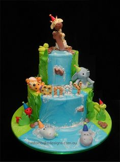 Baby Jungle 1st Birthday Cake - This cake was made for little Andy who is celebrating his 1st birthday. His mum wanted a jungle themed cake with a waterfall and baby jungle animals in nappies with party hats. This choc mud cake caters for 60 desert / 120 coffee sized portions
