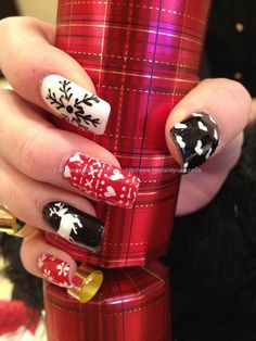 Red, black and white freehand Christmas nail art