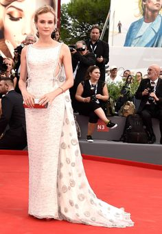 Diane Kruger dazzled on the red carpet in a Prada gown complete with a shimmering embroidered cape.