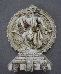 While we're still on the subject of calendars, here's another Aztec calendar integrated into this sculpture, $99. 1/4/13