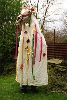 The Mari Lwyd (the Grey Mare) is a pagan tradition said to bring good luck. People decorate a horse's skull with decorative ears and eyes attached; adorn it with colorful reins, bells, ribbons and wrapped it with a white sheet and carry it on the end of a pole. Then the group goes door-to-door singing and challenging the families inside to a battle of rhyming insults in Welsh. At the end of the battle of wits (known as pwnco) the group would be invited into the house for refreshments.