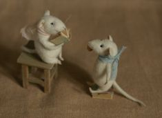 two mice reading a book