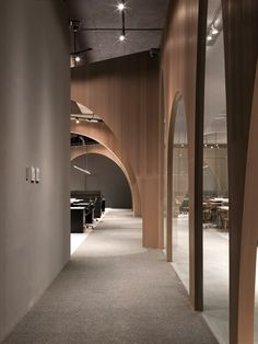 "Wooden partitions with arch-shaped cutouts are used to separate the workspaces from an indoor ""courtyard"" inside fashion brand H&M'slogistics office in Taiwan. The office on the outskirts of Taipei. Commercial Interior Design, Office Interior Design, Commercial Interiors, Office Interiors, Interior Design Inspiration, Design Ideas, Discount Interior Doors, Grey Interior Doors, Luxury Interior"