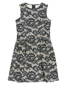 So pretty for holiday parties in a printed lace floral dress with ruffle pockets.  Just bought this for my daughter!  love it!