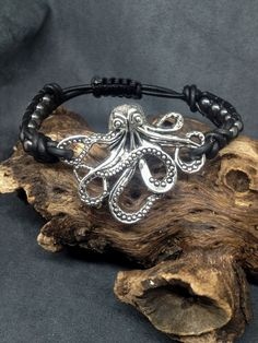 Octopus Bracelet, Octopus on Black Leather, Hematite Beads, Goth bracelet, Rocker bracelet, Boho bracelet,Adjustable band fits man or woman. by KarenMSmithDesigns on Etsy