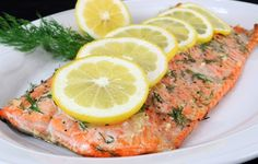 Garlic Salmon Recipe: A very healthy and quick dinner! Will be ready in 20-25 minutes.   Salt and pepper 1.5 pounds of salmon filet to taste, sprinkle with minced garlic gloves (3) and chopped fresh dill (1-2 springs).   Preheat oven to 450 degrees F, in an aluminum foil place prepared salmon fillet, top it with slices of lemon.   Cover the salmon with a second layer of aluminum foil and bake for 20-25 minutes!