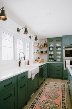 Kitchen Cabinet Inspiration A round-up of the best green kitchen cabinet paint colors for the hottest bold kitchen color trend.A round-up of the best green kitchen cabinet paint colors for the hottest bold kitchen color trend. Green Kitchen Cabinets, Painting Kitchen Cabinets, New Kitchen, White Cabinets, Colored Cabinets, Awesome Kitchen, Rustic Kitchen, Kitchen White, White Counters