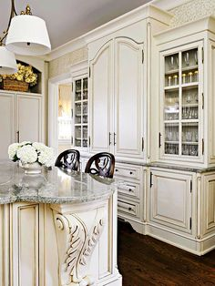 Traditional French Kitchen: Style + Storage built-in cabinets were used to form a massive hutch that offers ample room for storage and display.