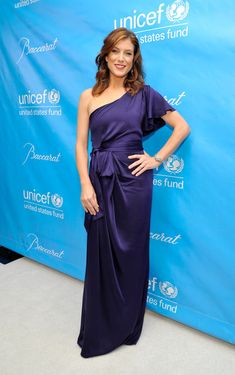 Kate Walsh One Shoulder Dress - Kate Walsh wore a one-shoulder blue silk evening dress with a butterfly sleeve for the UNICEF Ball.
