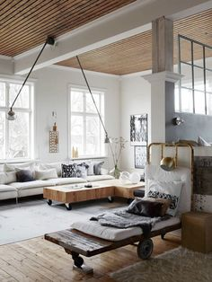 If large, open, lofted spaces and rugged materials like raw wood and metal catch your eye, your home style may be warm industrial. Here are 11 inspiring spaces that showcase the classic style and reveal how cozy, modern, and even rustic the look can be.