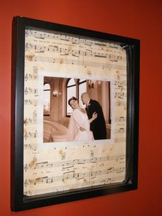 picture framed and put on sheet music of the wedding song- tea and coffee stained to antique it