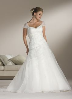 this one too, with or without the sleeves Sincerity plus wedding dress style 4508 Tulle cap sleeves(detachable) sweetheart asymmetrical draped aline, beaded lace appliques, corset back, chapel length train.