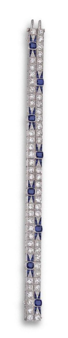 SAPPHIRE AND DIAMOND BRACELET, GATTLE, CIRCA 1920.  The articulated band set at intervals with 8 cushion-shaped sapphires flanked by short tapering rows of calibré-cut sapphires, completed by 72 old European-cut diamonds weighing approximately 9.50 carats, mounted in platinum, length 7 inches.