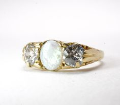 Vintage Opal And Diamond Ring October Birthstone Old Mine Cut Diamonds Antique Wedding Bands, Antique Engagement Rings, Antique Rings, Vintage Rings, Emerald Cut Engagement, Engagement Ring Cuts, Thin Diamond Band, Diamond Cuts, Opal Rings