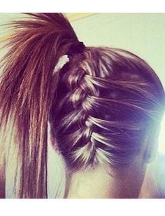 Worried about loose strands falling out of a ponytail during your workout? Try a braided ponytail instead!