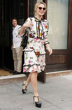 f0bbb0c3481 Demure  Margot Robbie looked lovely in a floral patterned dress as she was  spotted stepping