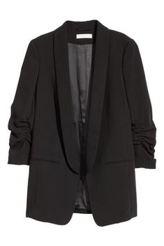 Fitted jacket with rounded lapels, welt front pockets, 3/4-length sleeves with gathered seams and a single back vent. The jacket has no fasteners. Lined.