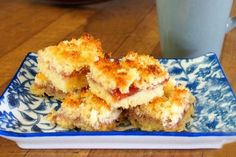Coconut Jam Slice - just like Nanna used to make! This recipe is an oldie but a goodie - delicious biscuit base with a jam filling and deliciously sweet coconut topping! Who said it had gone out of fashion!