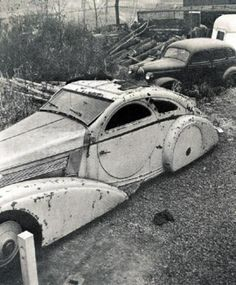 "Hooper bodied 1925 Phantom I -- ""The Round Door Rolls Royce"" in NJ junk yard in 1950s. Now restored (in black) and in the Peterson Museum collection."
