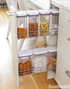 A space-saving pullout serves as the snack station. See More: 80+ Amazing Designer Kitchens The Best Kitchens of 201515 Great Decor Ideas for Your Kitchen