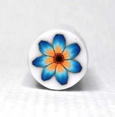 Turquoise polymer clay flower cane by sigalsart on Etsy, $6.50