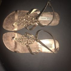 Copper colored summer Sandals Sandals look more gold in picture but in person they are a little more of a copper color.  Very cute,  very gentle wear and leather upper. Steve Madden Shoes Sandals