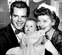 Lucille Ball and Desi Arnaz with daughter